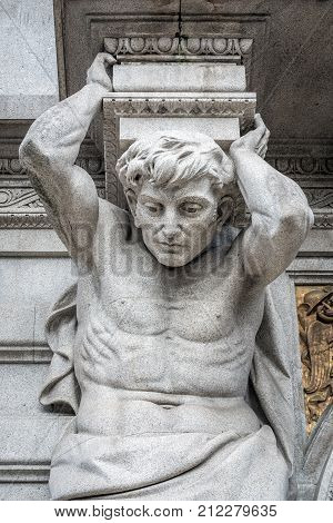 Atlas statue on a frontage of City Hall of Porto Portugal
