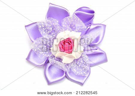 elastic with an elastic band on a white background flower purple hand made
