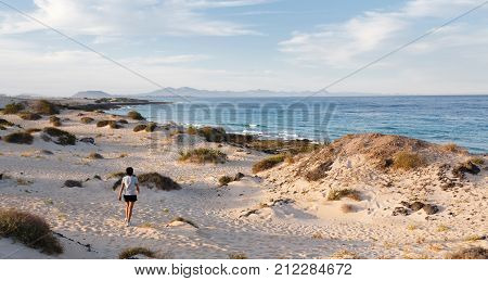 Woman exercising outdoors on a beach in Fuerteventura