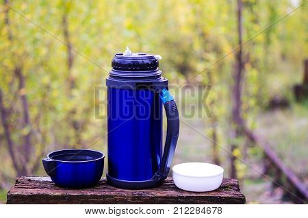 Thermos For Drinks. Thermos With Two Mugs. With A Thermos On The Nature. Camping With A Thermos. Fal