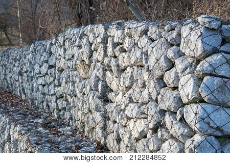 Retaining stone wall next to the road