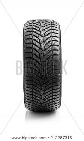 Winter tire. Winter tire of the car on a white background.