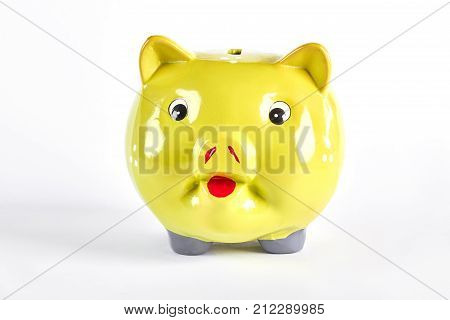 Yellow piggy bank isolated over white. Yellow piggy bank for money savings isolated on white background.
