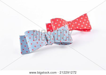 Fabric bow ties on white background. Blue and red hair bows isolated on white background. Girs elegant hair accessories.
