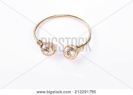 Gold bracelet on a white background. Female beautiful bracelet isolated on white background. Woman luxury jewelry.