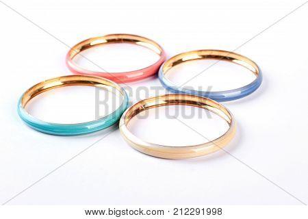Beautiful bracelets on white background. Fashion design bangles isolated on white background. Woman stylish accessories.