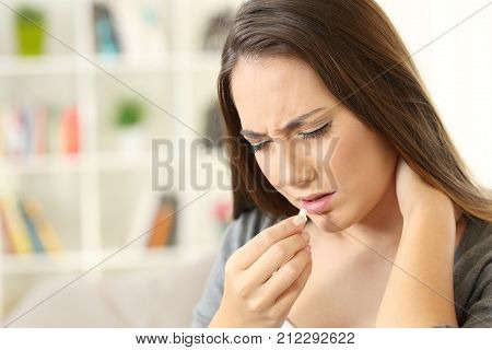 Woman Suffering Neck Ache Eating A Pill