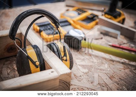 Ear Muffs Woodwork Safety. Noise Reduction Headphones. Construction Theme.