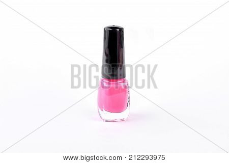 Bottle of pink nail polish. High quality nail varnish isolated on white background.