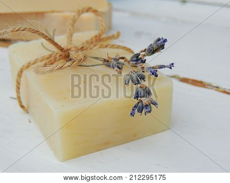 Handmade spa lavender soap on vintage wooden background. Soap making. Soap bars. Spa, skin care.