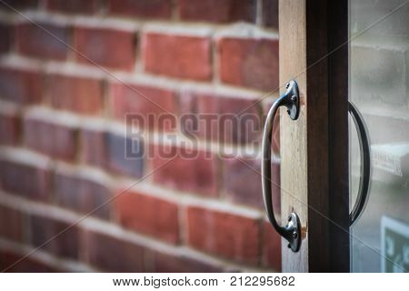 Old weathered wooden home doors handle detail