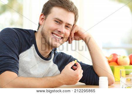 Man Holding Omega 3 Vitamin Pill