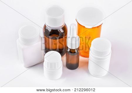 Set of medicine in glass and plastic bottles. Medicaments in different bottles for cold treatment. Medicine, health care and pharmaceutical drugs concept.