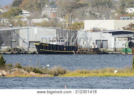 New Bedford Massachusetts USA - November 5 2017: Commercial fishing vessel Perception unloading in New Bedford harbor