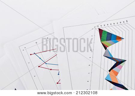 Document with colorful diagrams, white background. Financial data of the company, business document over whte background.