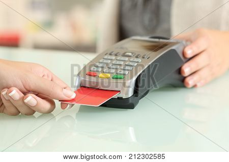 Seller Using A Dataphone To Charge With Credit Card