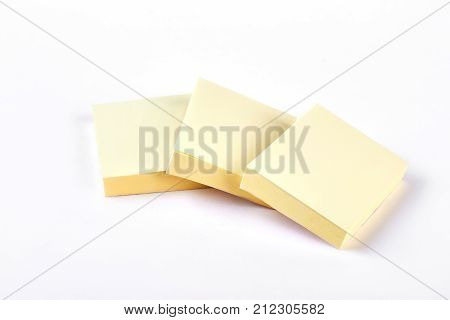 Three yellow sticky sticks. Blank sticky notes isolated on white background. Paper reminder stickers.