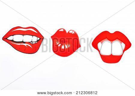 Female fake lips, white background. Three paper fake lips isolated on white background. Girls party concept.