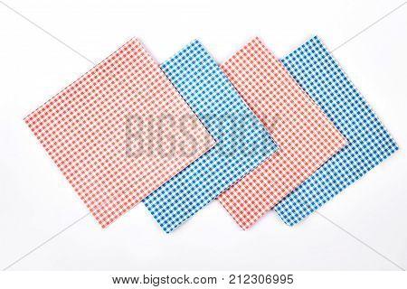 Set of cloth vintage napkins. Four checkered retro table napkins on white background. Collection of tablecloth napkin, top view.