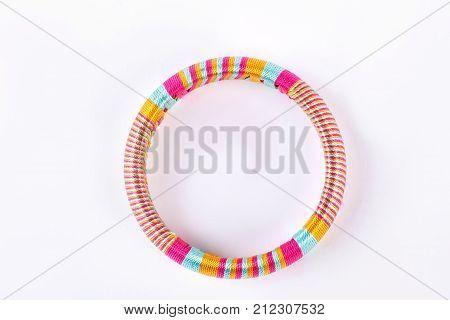 Colorful handmade bracelet, top view. Womna fashion bangle isolated on white background. Female elegant accessory on sale.