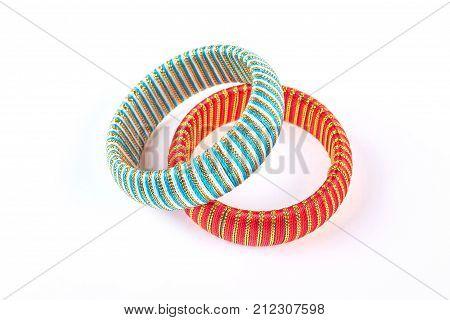 Elegant bracelets on white background. Two modern bracelets with golden thread on white background. Ladies luxury accessories.