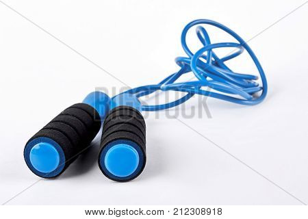 Blue skipping rope on white background. Modern jump rope isolated on white background. Equipment for workouts in gym.