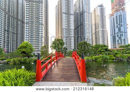 Ho Chi Minh City, Vietnam - November 30th, 2017: Path bridge over central park in busy urban areas showing prosperous economic development in Ho Chi Minh City, Vietnam