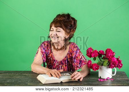 happy old lady or grandmother. Writer and poet granny read fairytale. Old woman reading book with glasses at flowers. Teacher or professor education teachers day. Pension and retirement old age.