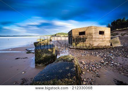 WW2 concrete anti tank blocks and pillbox on Roseilse beach, Moray, Scotland