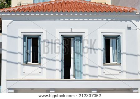 Skiathos Greek Island House Facade with two windows and one door