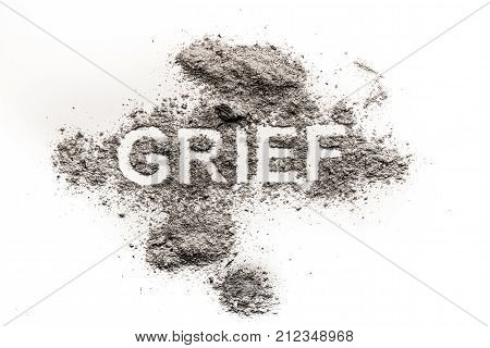 Grief word as sad emotion mourn for dead loved one or heartache for broken love written in dust as sadness pain or sorrow feeling concept background
