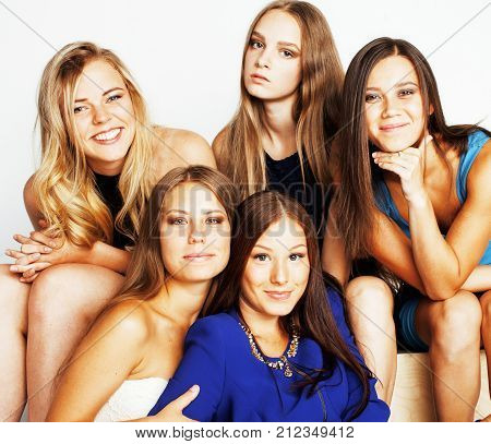 many girlfriends hugging celebration on white background, smiling talking chat close up, fancy dressed party on womans day. hen-party