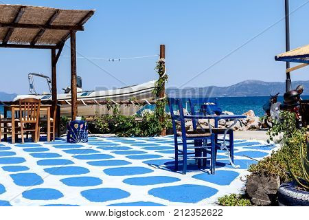 Abstract scene with colored floor as decoration detail at traditional Greek tavern restaurant.