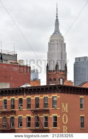 NEW YORK CITY USA - AUG. 29 : Empire State Building in Manhattan on August 29 2017 in New York City NY. Empire State Building is a Art Deco skyscraper in Midtown Manhattan New York City