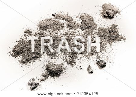 Trash word drawing made in dirt filth or dust as garbage nature ecology catastrophe concept and pollution background