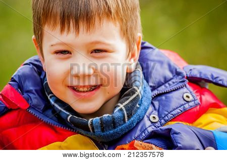 Happy smiling Caucasian child with black plaque on his teeth. Happy childhood stock image.