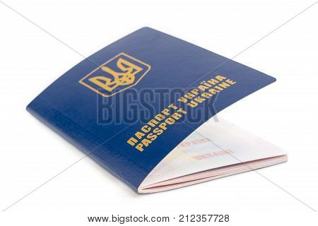 Ukrainian passport with slightly open front cover closeup on a white background