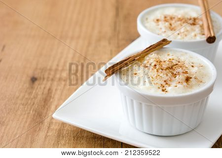 Arroz con leche. Rice pudding with cinnamon on wooden background.Copyspace