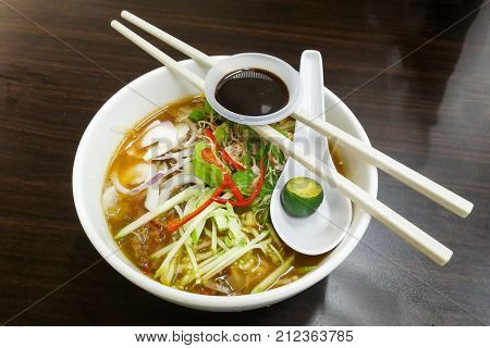 Penang Asam Laksa with prawn paste and lime popular Malaysian cuisine