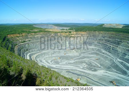 RUSSIA KACHKANAR - JUNE 18 2016: extraction of bauxite by open method in the quarry of the Kachkanarsky ore mining and processing enterprise Sverdlovsk region.