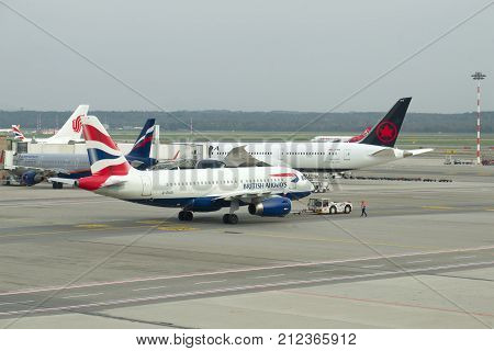 MILAN, ITALY - SEPTEMBER 29, 2017: Towage of the Airbus A319 (G-EUOI) of British Airways on a runway. Malpensa Airport