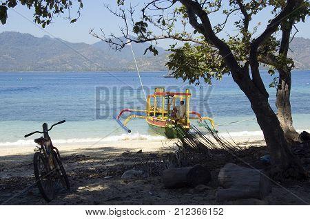 Boat, Man And Bike On Gili Islands, Indonesia