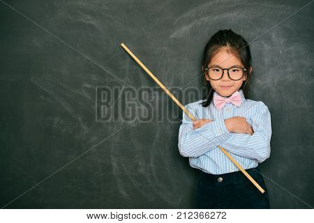 Attractive Little Female Teacher Holding Stick