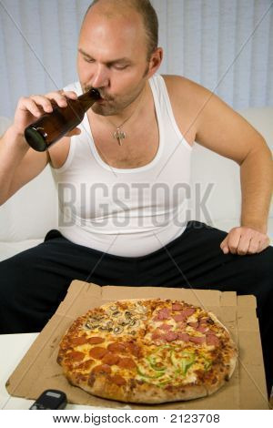 Preparing To Eat The Pizza