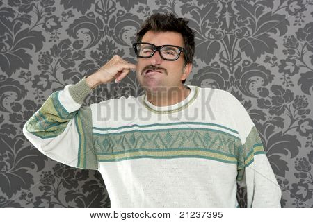 dirty nerd mustache man cleaning his ear with his finger