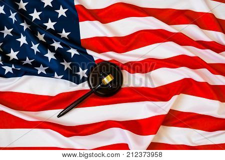Wooden Judge Gavel And Soundboard Laying Over Us Flag. Hammer And Gavel. American Law And Justice Co