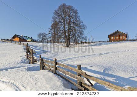 Wintry rural landscape. Village Markovskaya, Verkhovazhsky District, Vologda Region, Russia