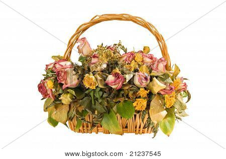 Woven Basket With Dry Up The Roses, Isolated On A White