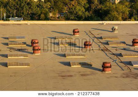 Rooftop of industrial buildings in a big city