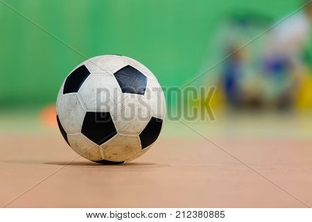 Indoor soccer sports hall. Football futsal ball and futsal floor. Sport Futsal background. Indoor Soccer Winter League